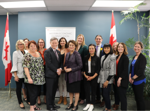 Carinna Rosales with Terry Duguid, Parliamentary Secretary to the Minister for Women and Gender Equality and Member of Parliament for Winnipeg South, Robert-Falcon Ouellette, Member of Parliament for Winnipeg Centre, and other funding recipients.